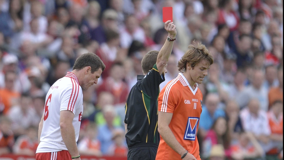 Armagh's Kevin Dyas leaves the field after being shown a red card by referee Joe McQuillan