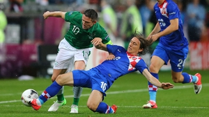 Robbie Keane and Luka Modric experienced contrasting fortunes in Poznan
