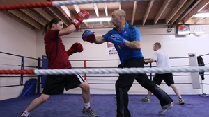Taylor is coached by her father, and former boxer, Pete (right). She'll compete in the 60kg lightweight division