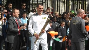Mark Kenneally with the Olympic torch