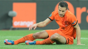 Down and (almost) out - Robin van Persie and his Dutch team-mates seem certain to suffer a premature ejection from Euro 2012