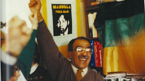Kader Asmal celebrates the news of the release of Mandela in his Dublin home.