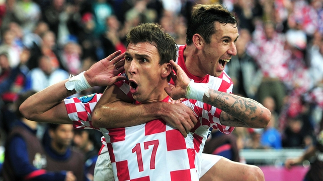 Mario Mandzukic celebrates scoring against Italy in Poznan