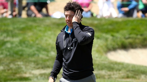 Rory McIlroy reacts after making a mess of the final hole