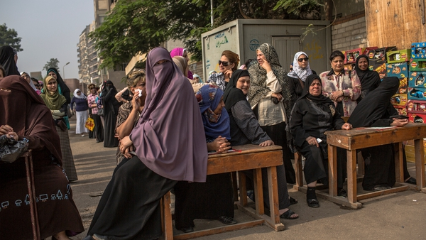 Egyptian women line up to cast their vote