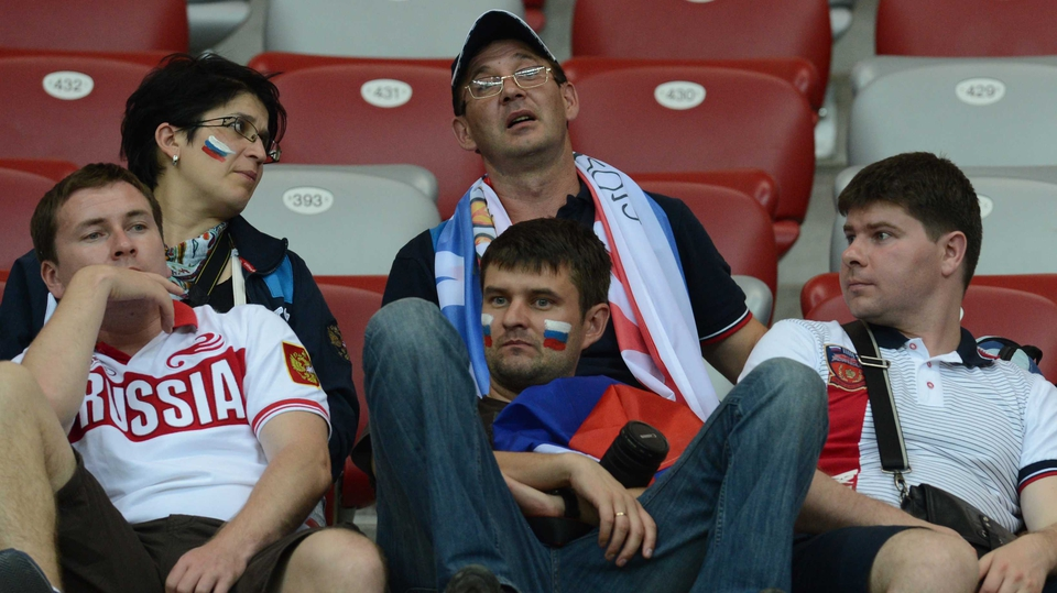 Russian fans after the game can hardly believe they are going home early