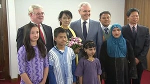 Aung San Suu Kyi was presented with flowers by Burmese-Ireland children