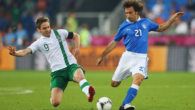 Kevin Doyle and Andrea Pirlo clash