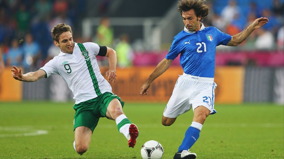 Kevin Doyle gets stuck into Andrea Pirlo early on