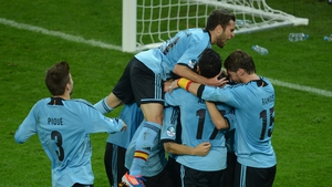 The Spanish players celebrate Jesus Navas' 88th-minute winner