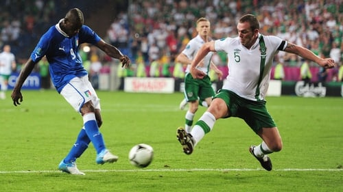 Richard Dunne blocks a Mario Balotelli effort during the European Championships