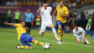 France's Frank Ribery skips past the challenge of Anders Svensson