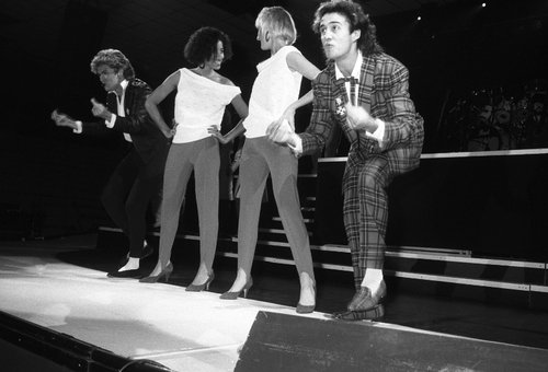 Andrew Ridgley in his Wham! days with George Michael, Pepsi and Shirley.