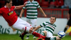 Shelbourne's Stephen Paisley gets stuck into Gary McCabe of Rovers