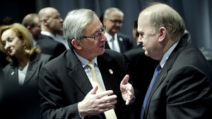 Michael Noonan, pictured with Jean Claude Juncker, announced the change in European Investment Bank's rules after today's ECOFIN meeting