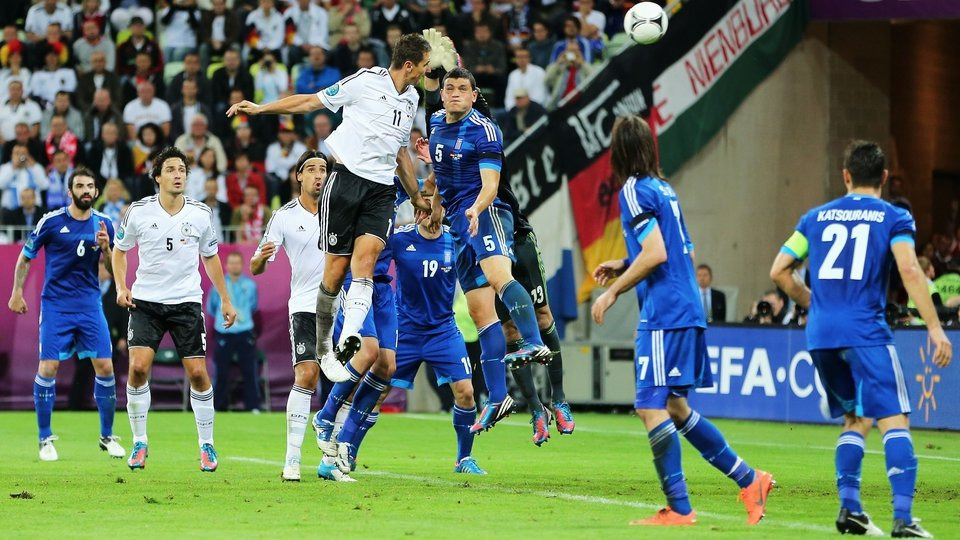 Miroslave Klose leaps to head home Germany's third