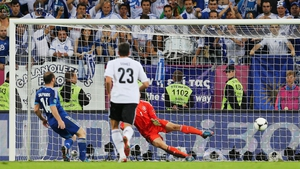 Dimitris Salpingidis scores a consolation goal for Greece from the penalty spot