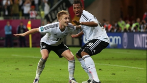 Marco Reus celebrates with Jerome Boateng after scoring Germany's fourth