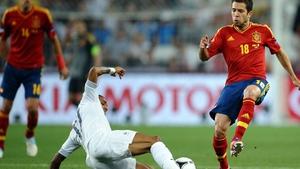 Jordi Alba of Spain challenges Yann M'Vila of France