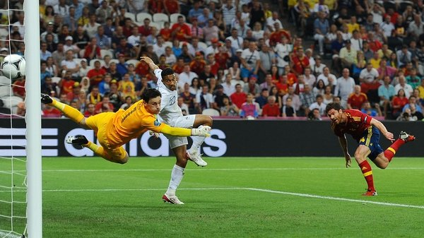Xabi Alonso heads home the opener for Spain