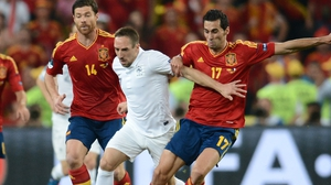 French midfielder Franck Ribery (L) vies with Spanish defender Alvaro Arbeloa