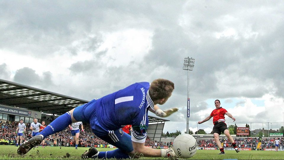 Down's Aidan Carr scores a penalty past Monaghan goalkeeper Mark Keogh