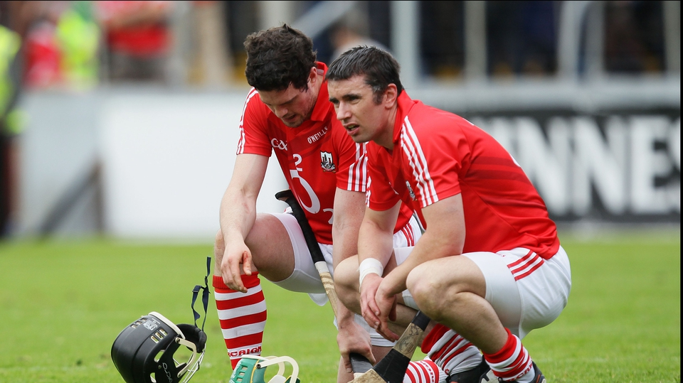 Cork's Shane O'Neill and Brian Murphy show their upset after the loss