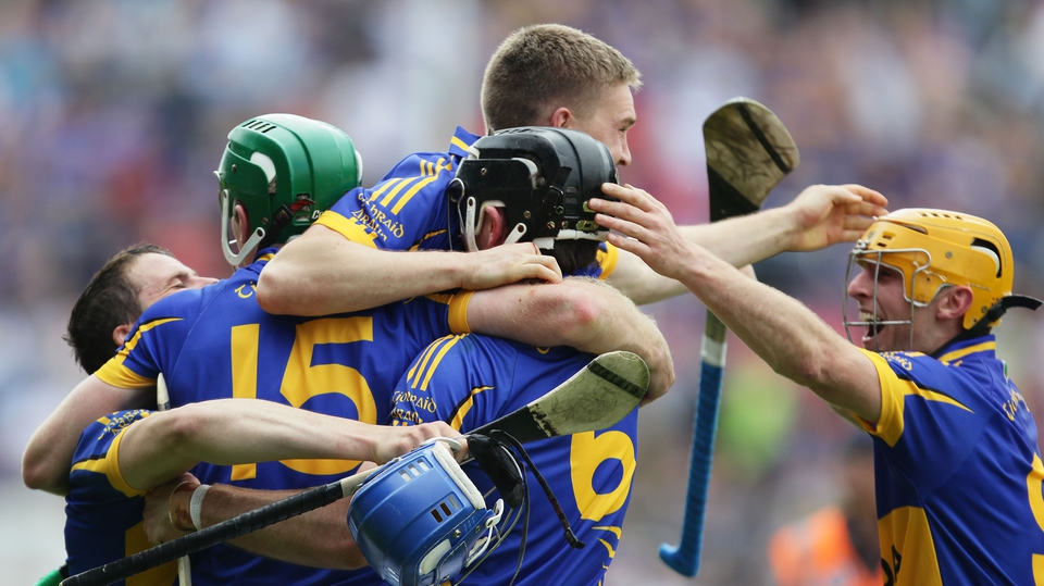 Tipperary players celebrate reaching the Munster final