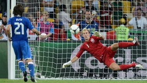 Joe Hart dives to his right as Andrea Pirlo clips the ball down the middle