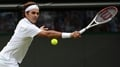 Federer eases into the semi-finals