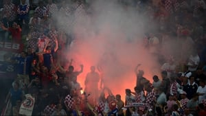 Croatia fans set off a flare during their game with Spain in Gdansk