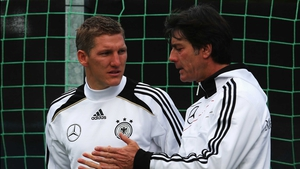 Bastian Schweinsteiger (l) and Joachim Loew deep in discussion during training in Gdansk yesterday