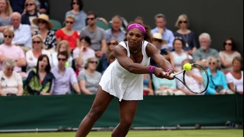 Serena Williams hits a backhand return on Court Two at SW19