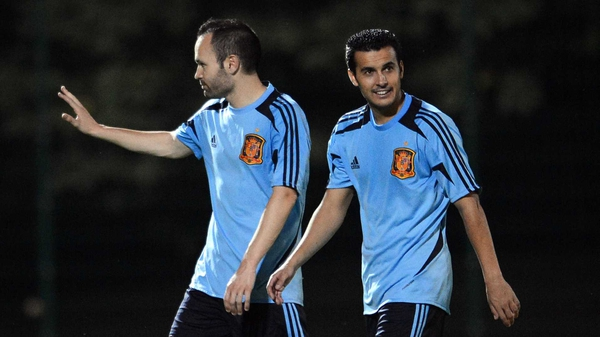 Andres Iniesta (L) and Pedro Rodriguez at the end of a training session yesterday