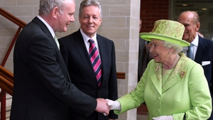 In 2012 Britain's Queen Elizabeth and McGuinness meet for the first time and shake hands