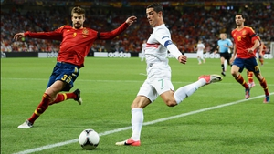 Ronaldo gets in a cross despite the attentions of Spanish defender Gerard Pique