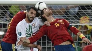 Portugal's Hugo Almeida is caught in a Pique-Sergio Ramos sandwich