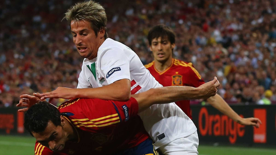 Fabio Coentrao is held off by Alvaro Arbeloa