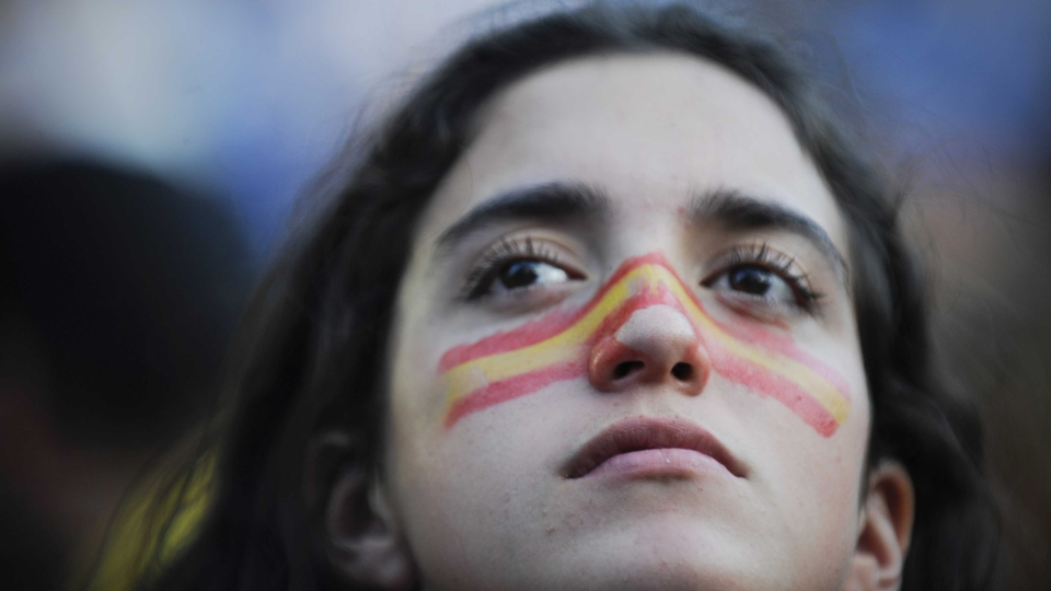 A Spanish supporter watches anxiously as her side struggles to break down a stubborn Portugal outfit