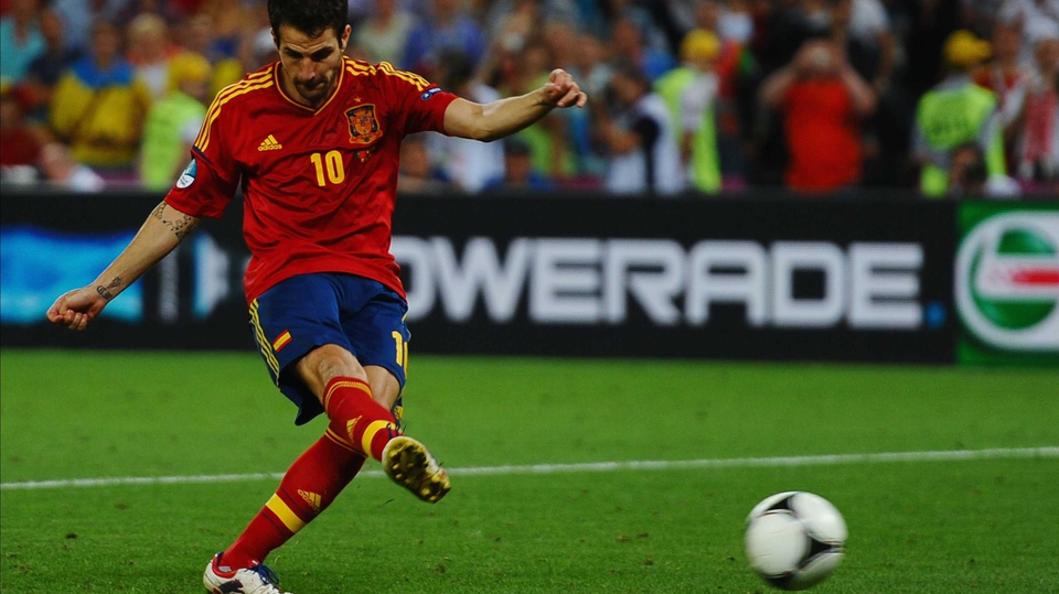 Cesc Fabregas converts the winning penalty