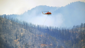 Firefighting efforts have been hampered by strong winds