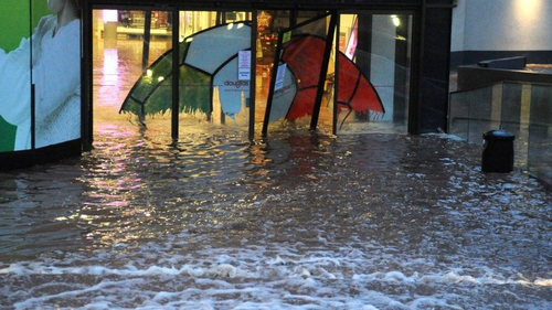 Water breaks through a shop's doors in Douglas, Cork (submitted by Catriona Casey via yourphotos@rte.ie)
