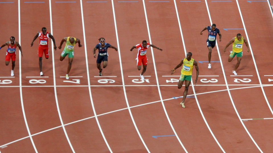 ...as he left his opponents trailing in his wake to win gold in the 100m, 200m and 4x100m relay