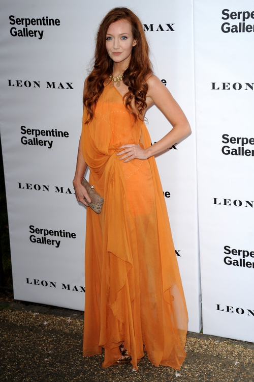 Olivia Grant rarely does wrong in our book and we are always floored by how well her skin and hair tones match the outfits that she wears. The Summery orange chiffon dress is to die for