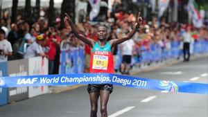 Abel Kirui crosses the line at the World Championships in Daegu in 2011