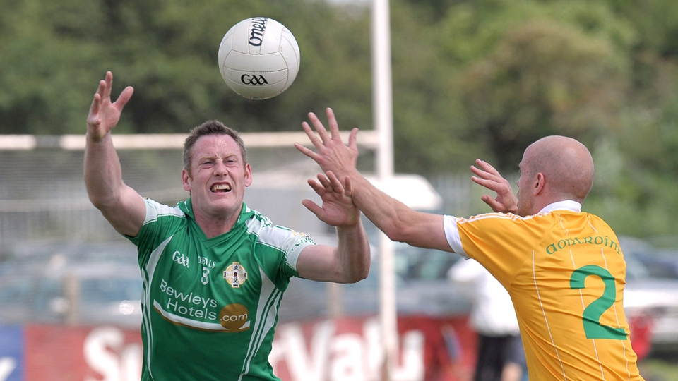 London's Lorcan Mulvey with Anto Healy of Antrim