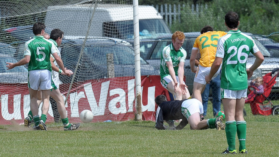 Antrim's Kevin Niblock scores the decisive goal in the win over London