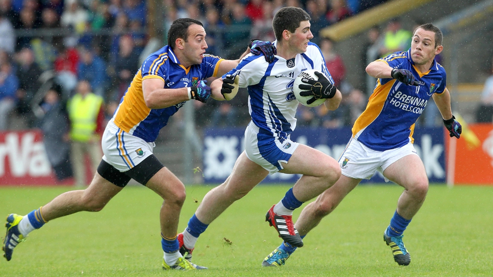 Wicklow's Anthony McLoughlin and John McGrath tackle Paul Whyte of Waterford
