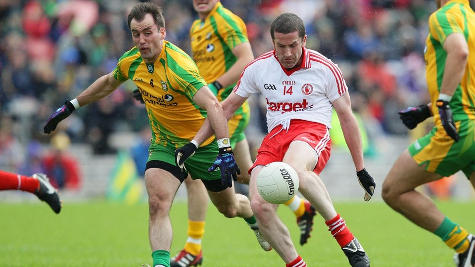 Tyrone's Stephen O'Neill and Karl Lacey of Donegal
