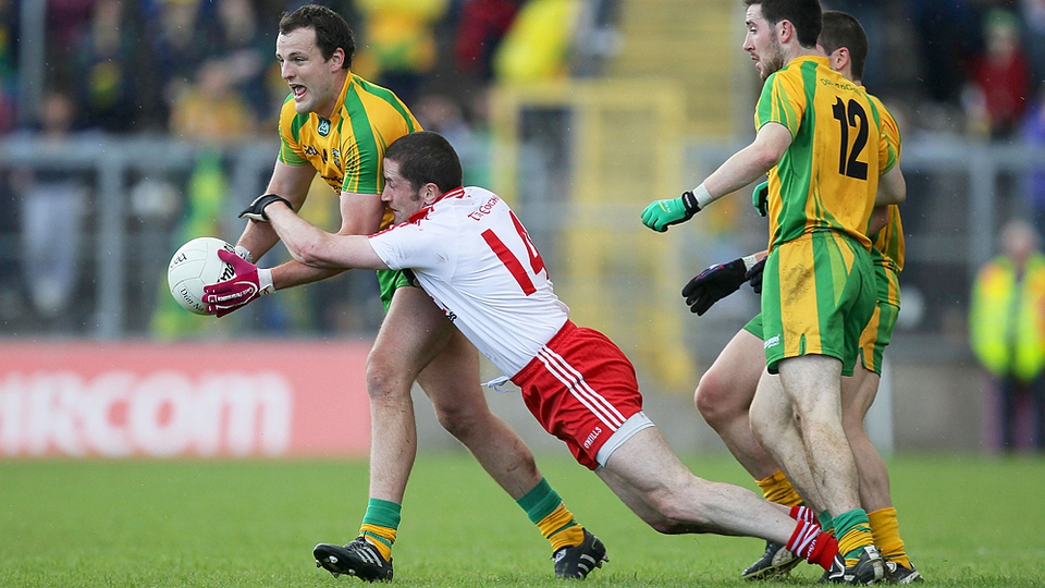 Tyrone's Stephen O'Neill tackles Michael Murphy of Donegal